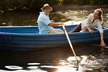 side view of person rowing in boat - Couple in Rowboat Stock Photo - Premium Royalty-Free, Code: 600-01717982
