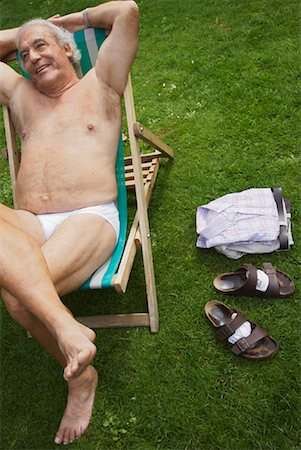 Man Sitting in Lawn Chair in His Underwear Stock Photo - Premium Royalty-Free, Code: 600-01717990