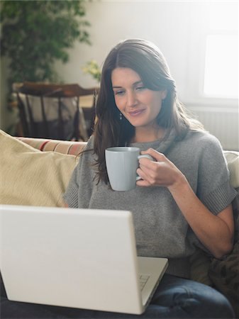 Portrait of Woman using Laptop Computer Stock Photo - Premium Royalty-Free, Code: 600-01742749