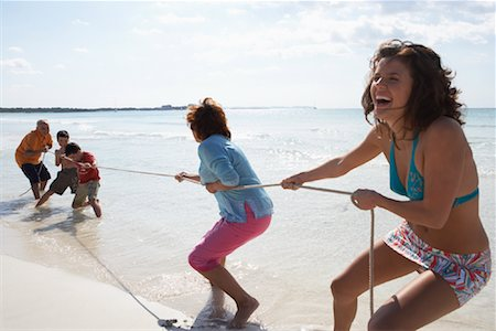 Family Playing Tug-of-War on the Beach Stock Photo - Premium Royalty-Free, Code: 600-01755534