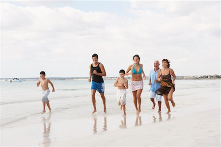 seniors woman in swimsuit - Family Running on the Beach Stock Photo - Premium Royalty-Free, Code: 600-01755540