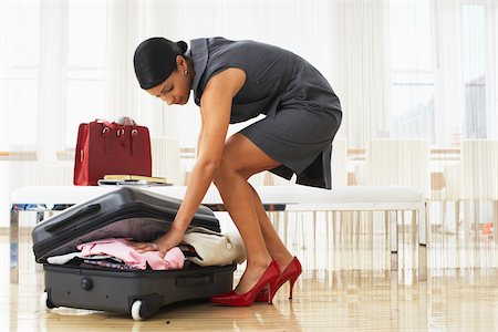 Woman Packing Suitcase Stock Photo - Premium Royalty-Free, Code: 600-01753610