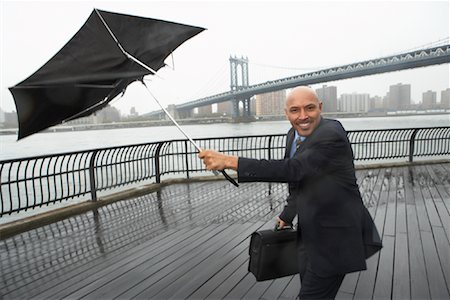 Businessman in Rainstorm by Brooklyn Bridge, New York City, New York, USA Stock Photo - Premium Royalty-Free, Code: 600-01764137