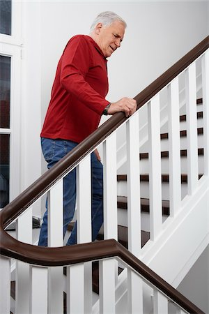 Man in Pain, Climbing Stairs Stock Photo - Premium Royalty-Free, Code: 600-01764447