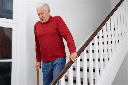 Man Descending Stairs Stock Photo - Premium Royalty-Free, Code: 600-01764449