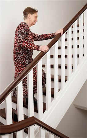 Woman Ascending Stairs Stock Photo - Premium Royalty-Free, Code: 600-01764453