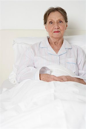 sleepy old woman - Portrait of Woman in Bed Stock Photo - Premium Royalty-Free, Code: 600-01764472