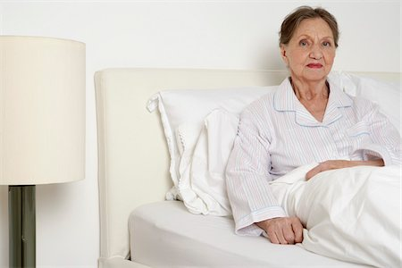 sleepy old woman - Portrait of Woman in Bed Stock Photo - Premium Royalty-Free, Code: 600-01764473