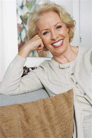 Portrait of Woman on Sofa Stock Photo - Premium Royalty-Free, Code: 600-01764561