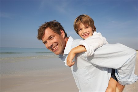 Father on Beach with Son, Majorca, Spain Stock Photo - Premium Royalty-Free, Code: 600-01764728