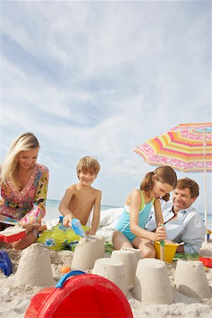Family Playing in Sand on Beach, Majorca, Spain Stock Photo - Premium Royalty-Free, Code: 600-01764736