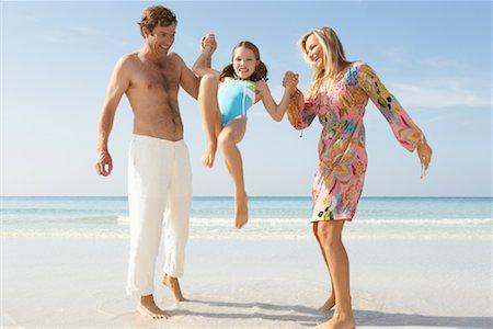 preteen girl feet - Parents Lifting up Daughter on Beach, Majorca, Spain Stock Photo - Premium Royalty-Free, Code: 600-01764733