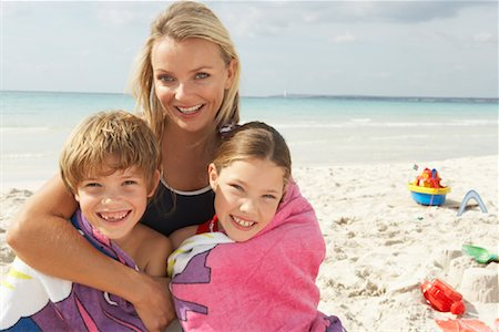 Portrait of Mother with Children on Beach, Majorca, Spain Stock Photo - Premium Royalty-Free, Code: 600-01764749