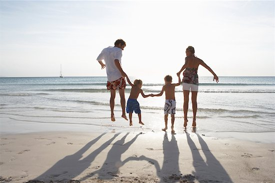 holding hands jumping.  Family beach holiday not i… family holding hands family holiday family