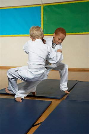 Boys Practicing Karate Stock Photo - Premium Royalty-Free, Code: 600-01764834