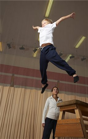 Boy Doing Gymnastics Stock Photo - Premium Royalty-Free, Code: 600-01764838