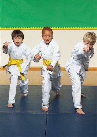 Boys Practicing Karate Stock Photo - Premium Royalty-Free, Code: 600-01764830