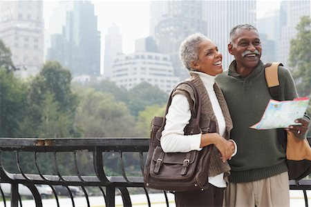 Couple in City with Map, New York City, New York, USA Stock Photo - Premium Royalty-Free, Code: 600-01787323