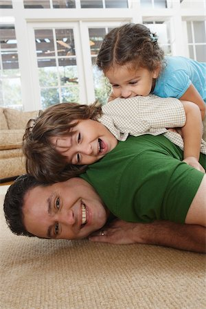 Father and Kids Play Fighting Stock Photo - Premium Royalty-Free, Code: 600-01787581