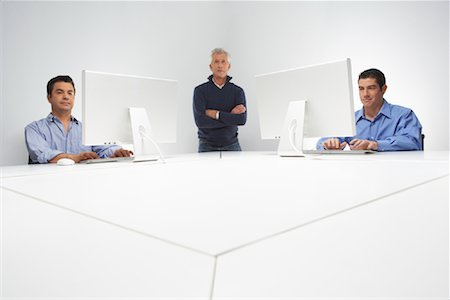 Portrait of Business Team with Computers Stock Photo - Premium Royalty-Free, Code: 600-01788840