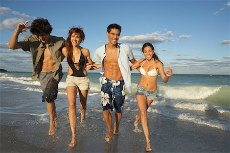 Group of People Running on the Beach Stock Photo - Premium Royalty-Free, Code: 600-01792424