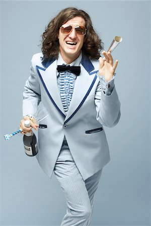 Man With Champagne and Noisemakers Stock Photo - Premium Royalty-Free, Code: 600-01837493