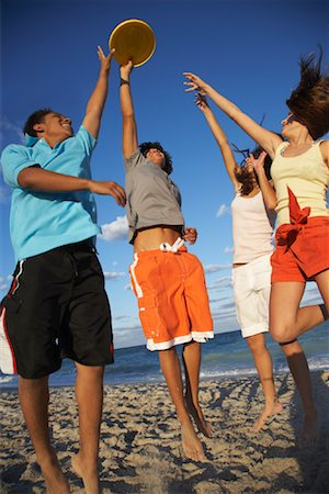 Friends Playing Frisbee on Beach Stock Photo - Premium Royalty-Free, Code: 600-01838215