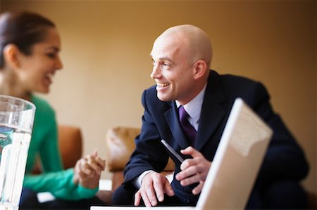 Woman Speaking With Consultant Stock Photo - Premium Royalty-Free, Code: 600-01879489