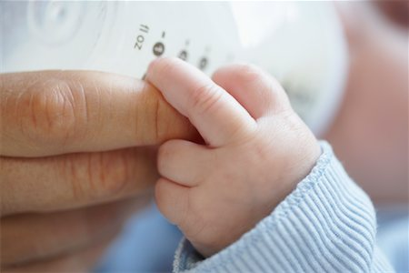 Baby Being Bottle Fed Stock Photo - Premium Royalty-Free, Code: 600-01887351