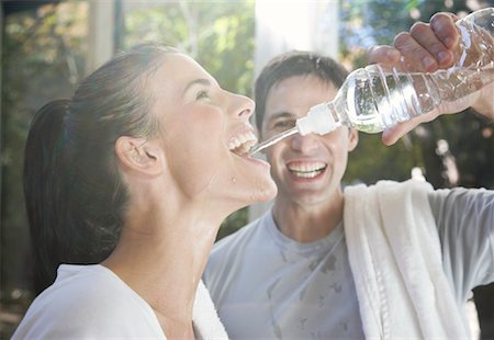 Man Squirting Water into Woman's Mouth Stock Photo - Premium Royalty-Free, Code: 600-01954808