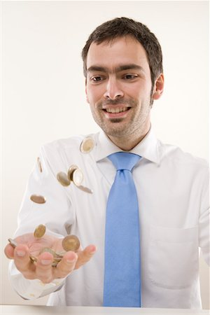 Man Tossing Coins Stock Photo - Premium Royalty-Free, Code: 600-02010039