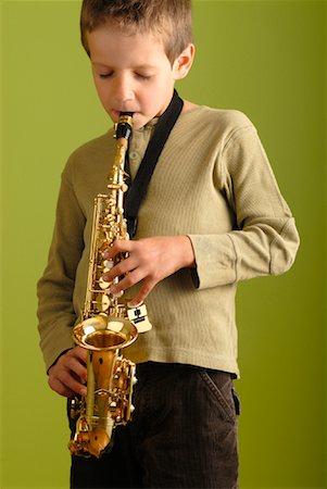 Boy Playing Saxophone Stock Photo - Premium Royalty-Free, Code: 600-02038298