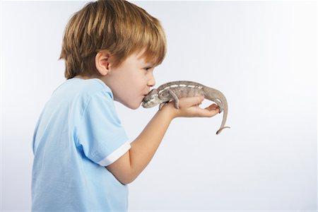 people kissing little boys - Boy Holding Lizard Stock Photo - Premium Royalty-Free, Code: 600-02055789
