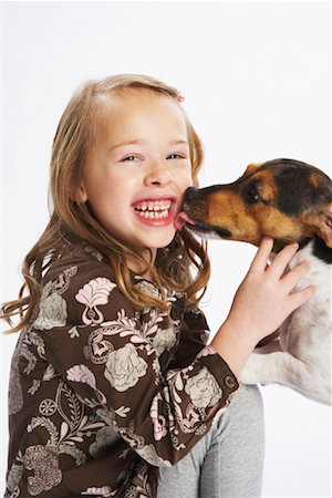 preteen girl licking - Girl with Dog Stock Photo - Premium Royalty-Free, Code: 600-02055841