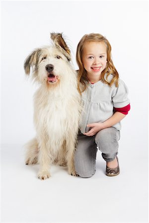 preteen  smile  one  alone - Girl with Dog Stock Photo - Premium Royalty-Free, Code: 600-02055874