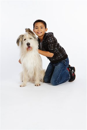 preteen  smile  one  alone - Boy with Dog Stock Photo - Premium Royalty-Free, Code: 600-02055872