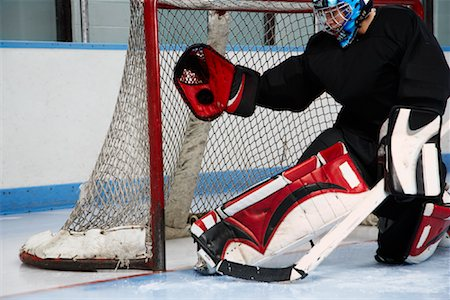 Goalie Making Save Stock Photo - Premium Royalty-Free, Code: 600-02056049