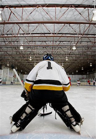 Rear View of Goalie During Hockey Game Stock Photo - Premium Royalty-Free, Code: 600-02056055