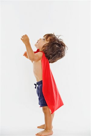 Little Boy Wearing Red Cape Stock Photo - Premium Royalty-Free, Code: 600-02056595