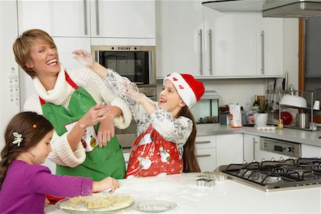 Mother and Daughter Making Christmas Cookies Stock Photo - Premium Royalty-Free, Code: 600-02071845