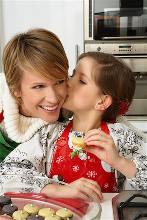 preteen kissing - Mother and Daughter Making Christmas Cookies Stock Photo - Premium Royalty-Free, Code: 600-02071850