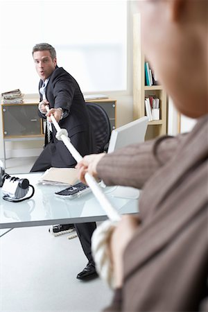 Business People in Tug-of-War at Desk Stock Photo - Premium Royalty-Free, Code: 600-02081761