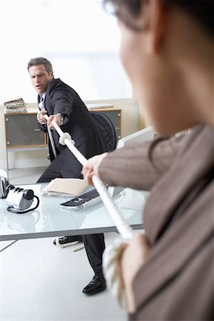 Business People in Tug-of-War at Desk Stock Photo - Premium Royalty-Free, Code: 600-02081762