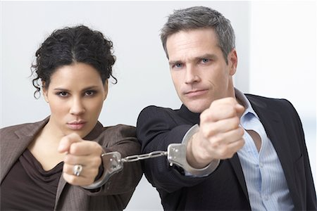sad lovers break up - Businessman and Businesswoman Handcuffed Together Stock Photo - Premium Royalty-Free, Code: 600-02081776