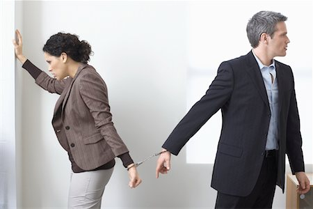 sad lovers break up - Businessman and Businesswoman Handcuffed Together Stock Photo - Premium Royalty-Free, Code: 600-02081770