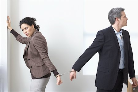 sad lovers break up - Businessman and Businesswoman Handcuffed Together Stock Photo - Premium Royalty-Free, Code: 600-02081771