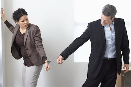 sad lovers break up - Businessman and Businesswoman Handcuffed Together Stock Photo - Premium Royalty-Free, Code: 600-02081772