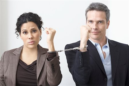 sad lovers break up - Businessman and Businesswoman Handcuffed Together Stock Photo - Premium Royalty-Free, Code: 600-02081773