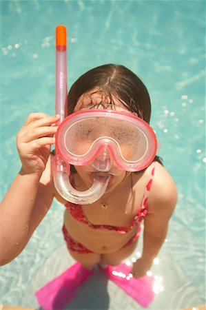 Girl Wearing Snorkel and Goggles Stock Photo - Premium Royalty-Free, Code: 600-02082090