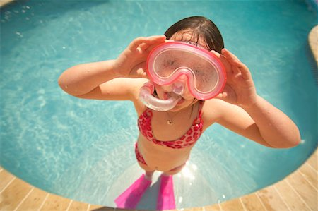 Girl Wearing Snorkel and Goggles in Swimming Pool Stock Photo - Premium Royalty-Free, Code: 600-02082092